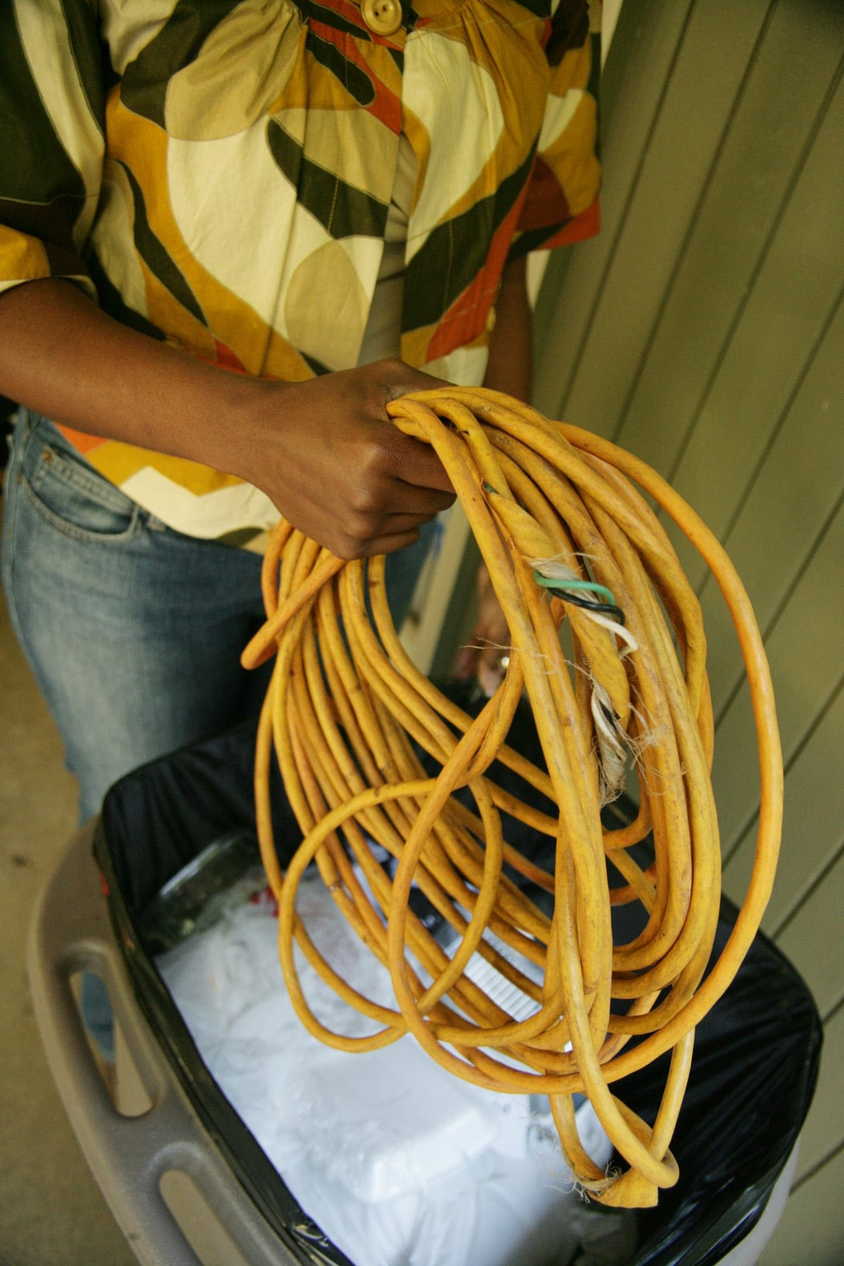Electrical Safety Photo Gallery American Plug Wiring African Woman With Frayed Cord Over Trash Bin