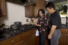 Asian-American couple cooking