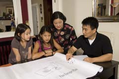 Asian-American family reviewing fire escape plan