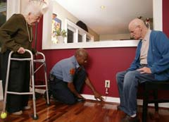 Older adults with fire personnel illustrating cord safety