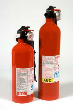 Two fire extinguishers on white background