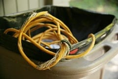 damaged electrical cords in a garbage can
