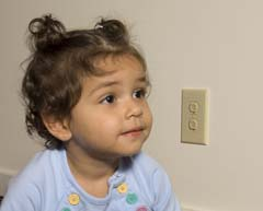 Close up of Hispanic child with outlets to the right