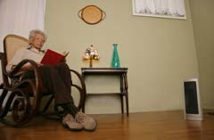 Woman in chair on right close with space heater off to right