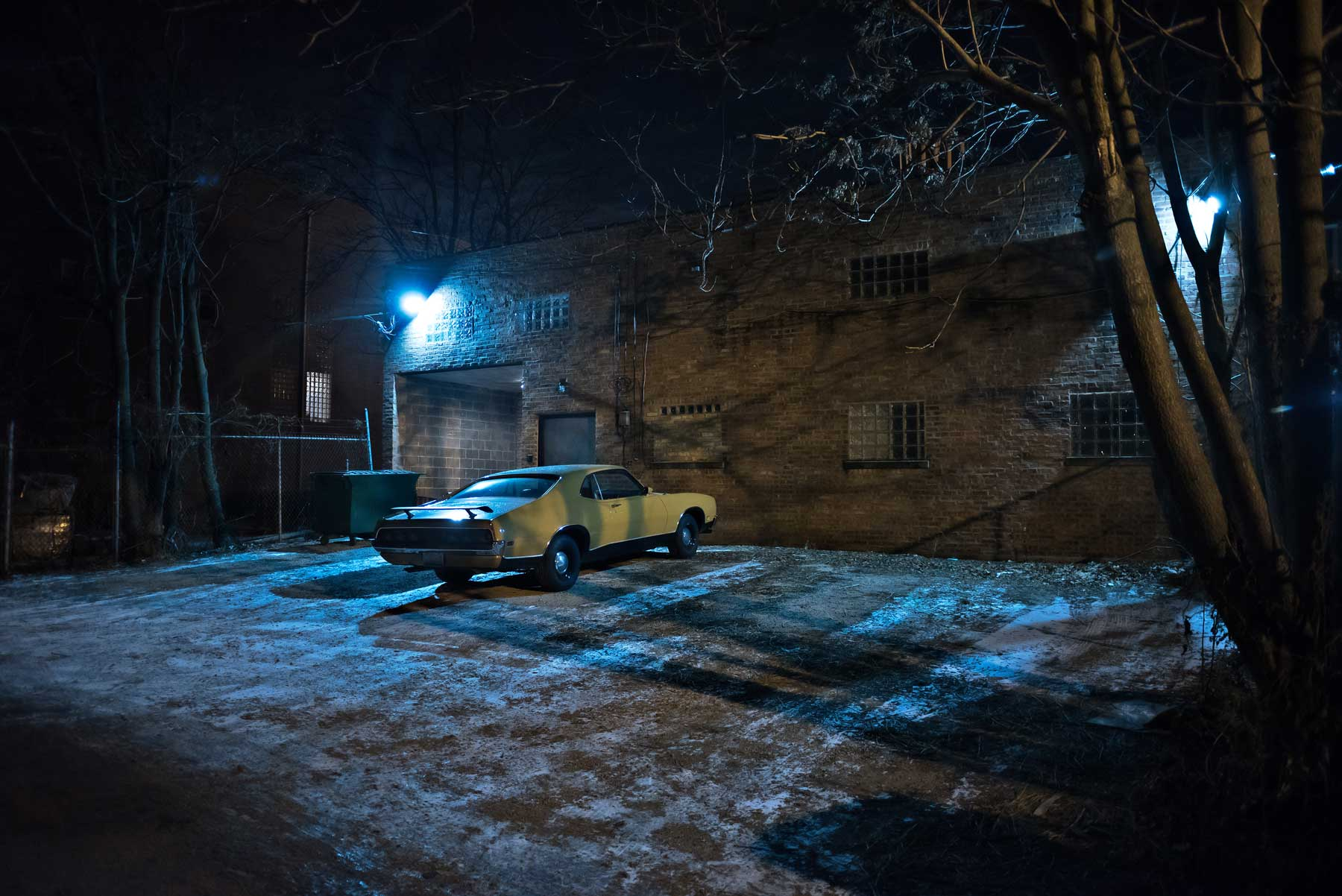 car in dark alley