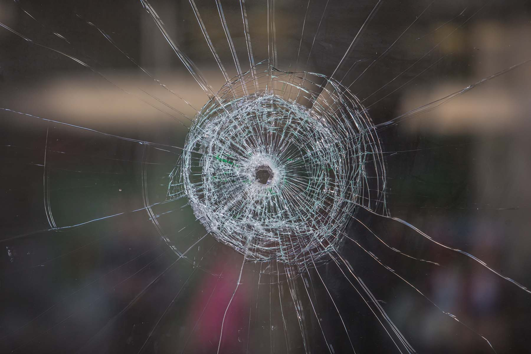 window with a bullet hole