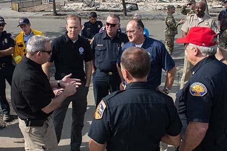 U.S. Fire Administrator Keith Bryant receives a briefing on the California wildfires.