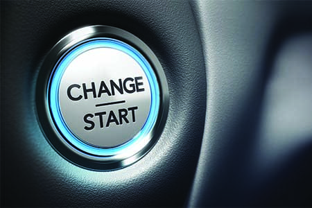 car ignition button that reads change, start