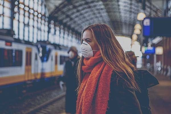 commuter wearing a mask in a train station