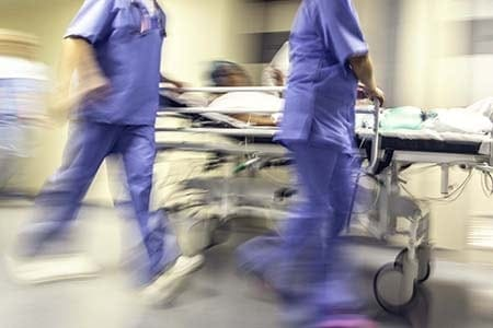 hospital staff pushing a patient with a blurred photo effect