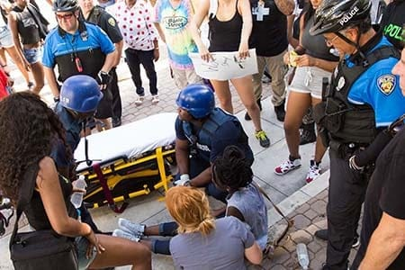 paramedics attending to a patient at a protest