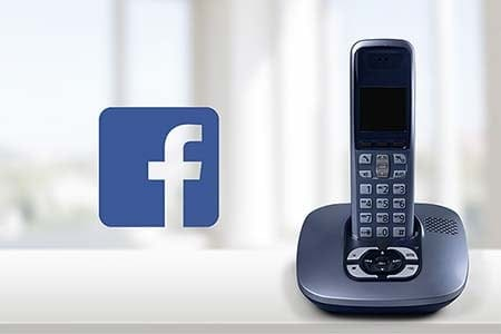 Facebook logo and a cordless phone