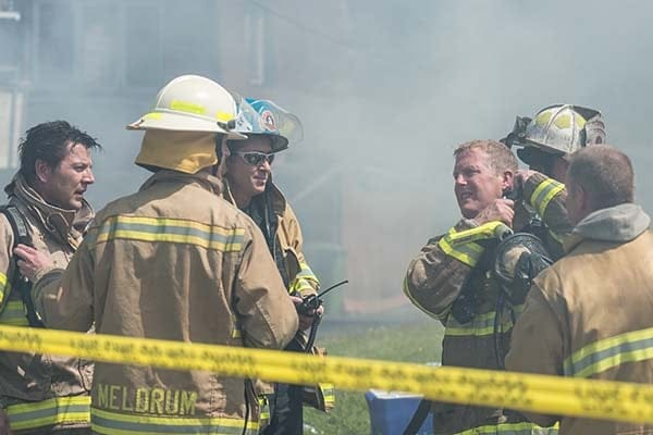 firefighter discussion at a fire scene