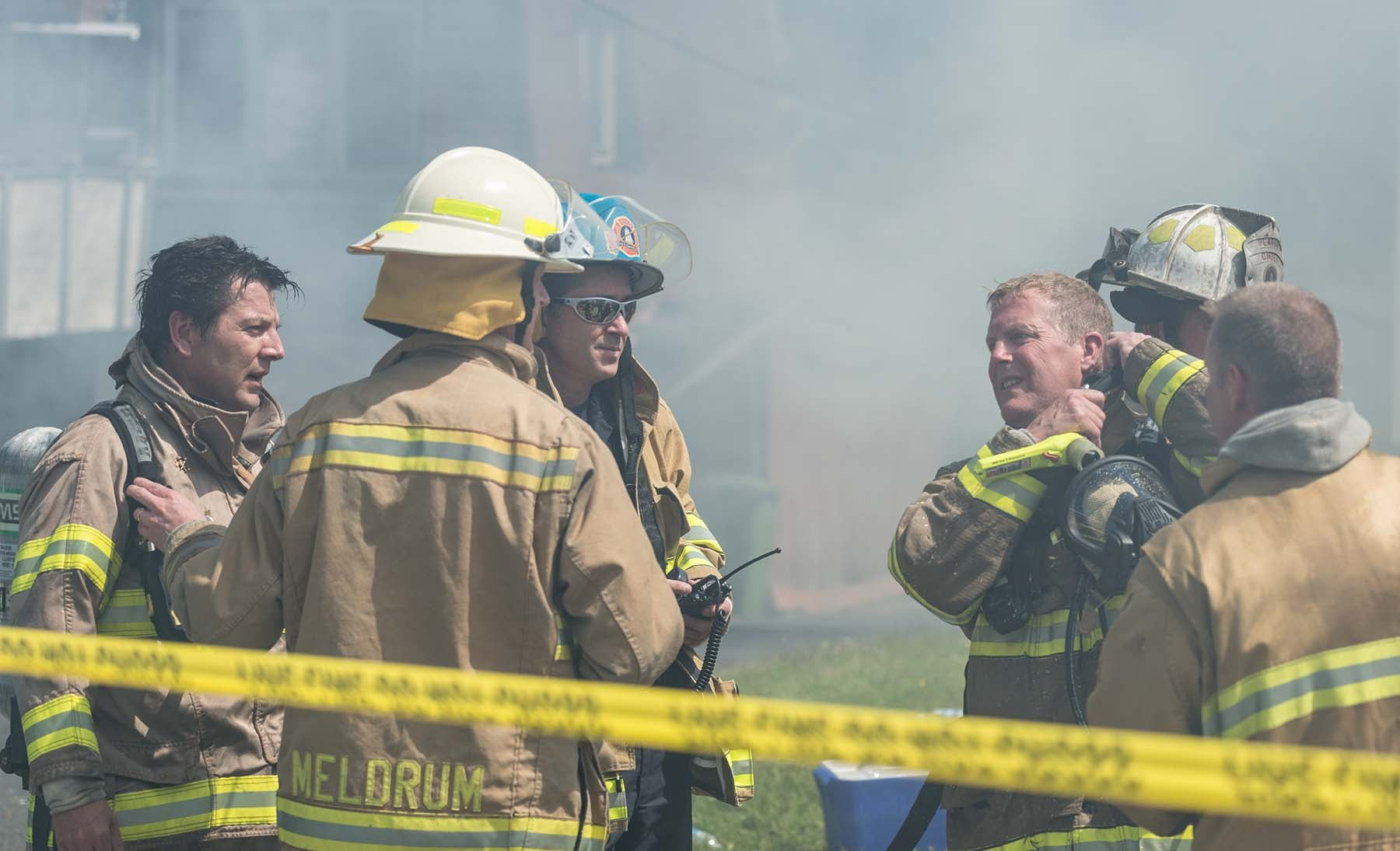 firefighter discussion at the scene of a fire