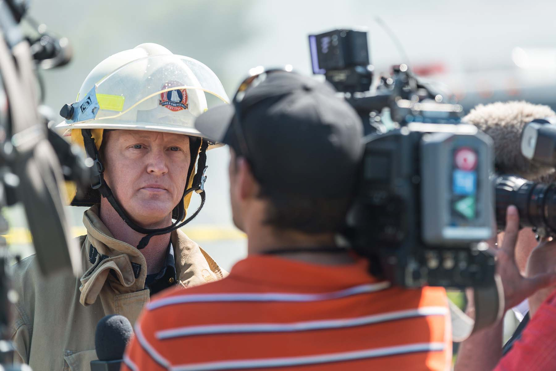firefighter giving an interview to the news media