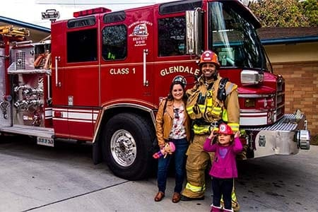 firefighter with a mom and her daughter