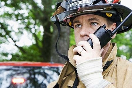 firefighter speaking into a radio