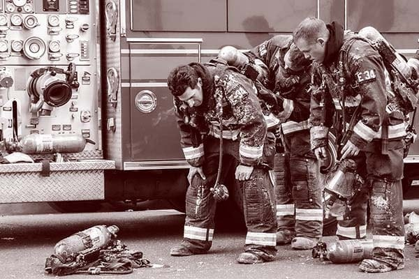 firefighters removing SCBA