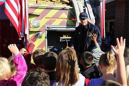 firefighter talking with children