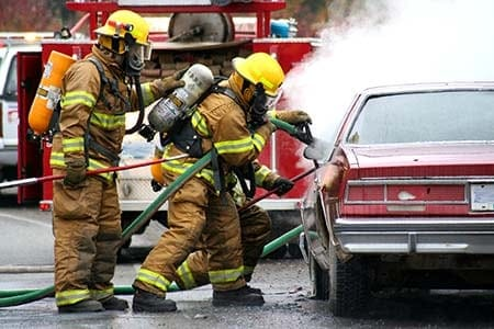 firefighters at a car fire incident
