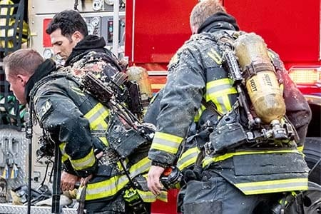 firefighters removing gear