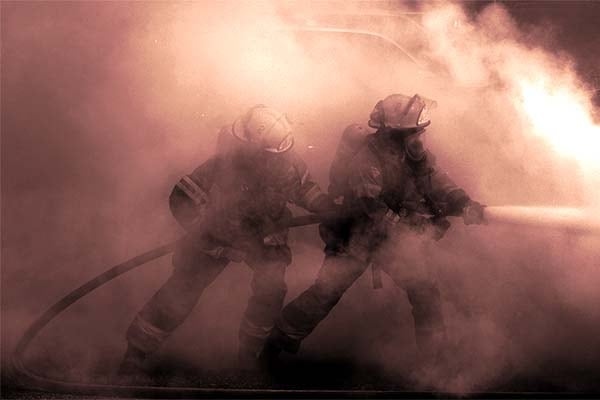 firefighters on hose line