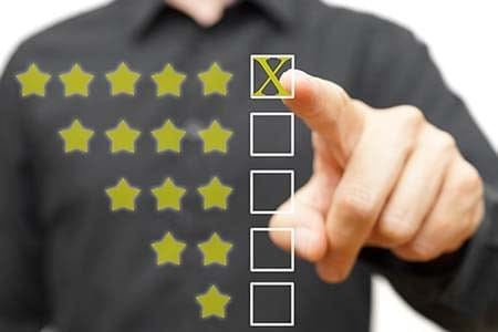 rating system with man pointing at five stars