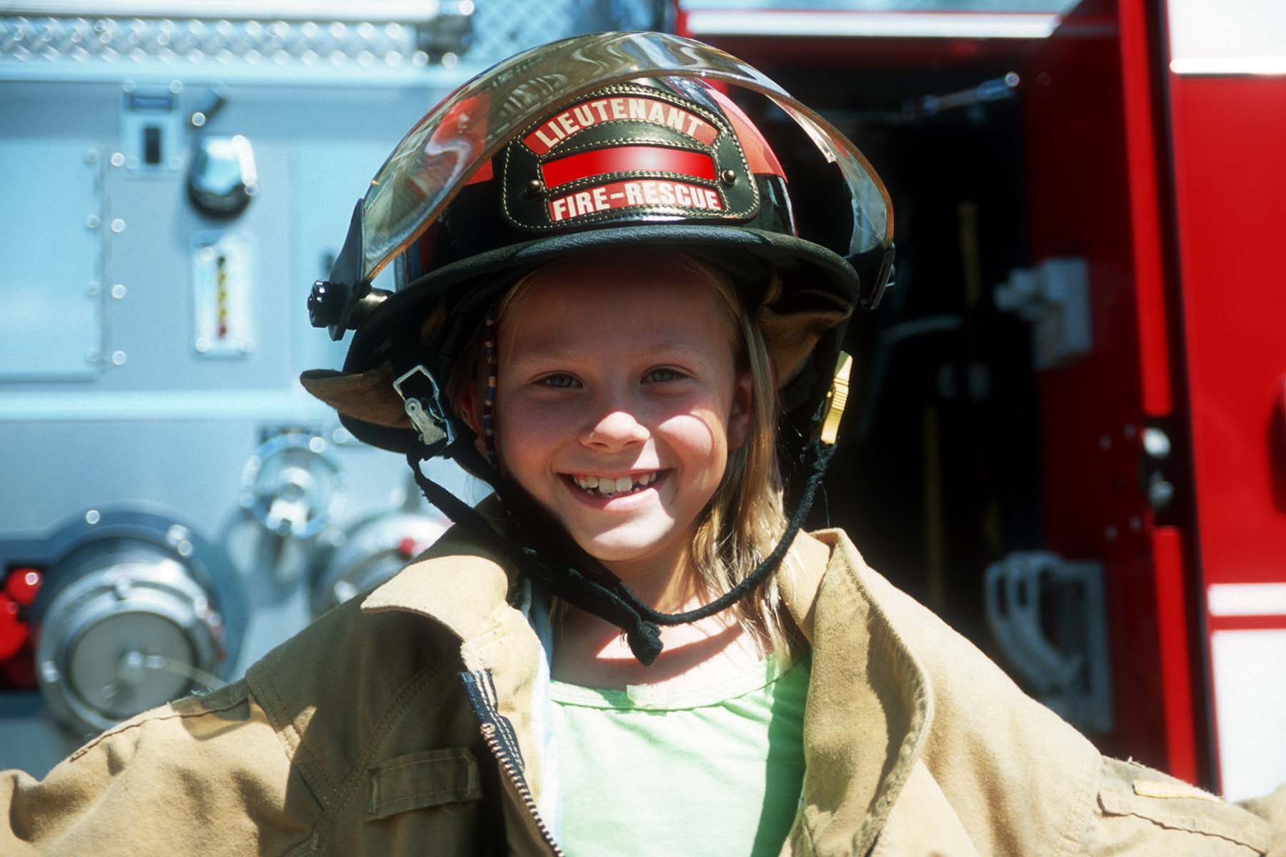 little girl dressed up as a firefighter