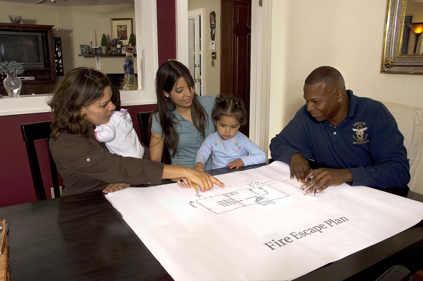 family with firefighter making a home escape plan