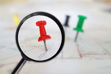 magnifying glass on a map pin