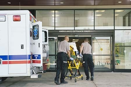 paramedics entering a hospital with a patient