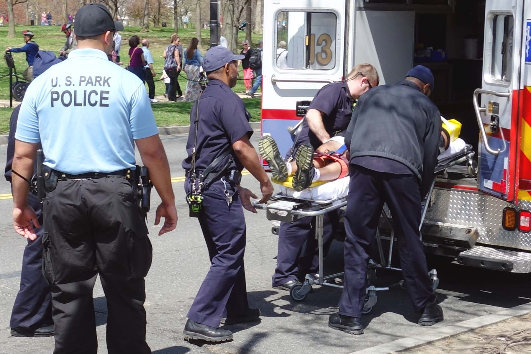 paramedics placing a patient into an ambulance