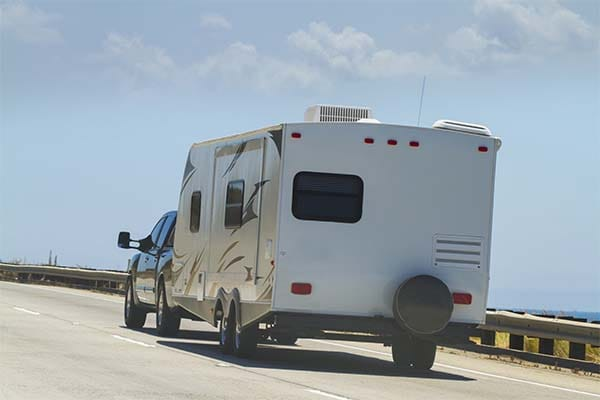 pickup truck hauling a recreational vehicle
