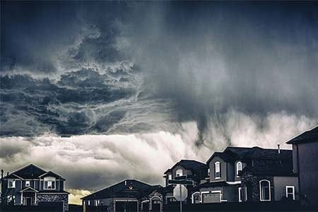 storm clouds with houses in the foreground