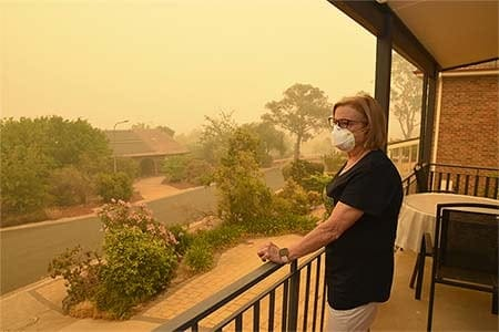 a woman wearing a mask during a wildfire