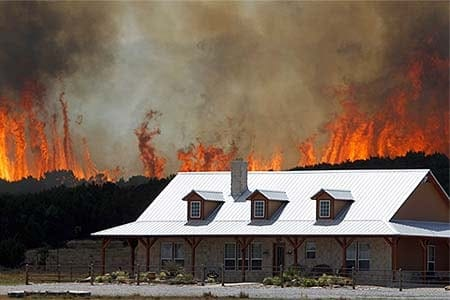 wildfire threatens home