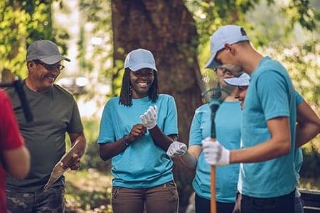 youth volunteers helping with forest cleanup